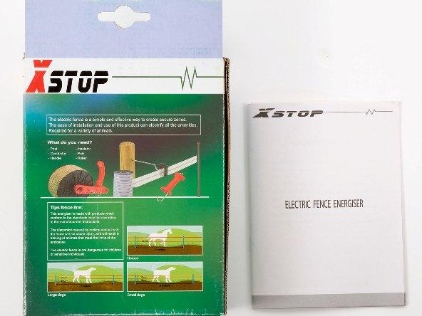 """Упаковка основного блока электронной изгороди """"X-Stop 10B"""" (вид сзади) с инструкцией по эксплуатации"""
