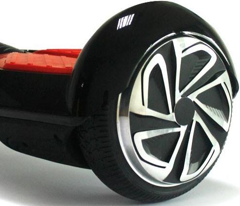 """Колеса гироскутера """"SLX-003 Transformers + Music"""" надежно защищены от грязи, пыли и осадков солидными крыльями"""